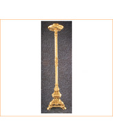Candelero de bronce con base triángular