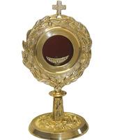 Relicario - custodia  de metal dorado con decoración en relieve