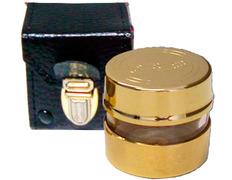 Crismera de metal dorado con estuche de piel