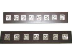 Vía Crucis con estaciones de madera y metal