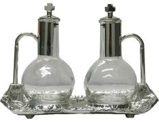 Vinajeras de cristal y metal plateado